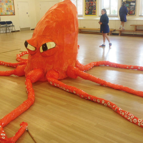 octopus puppet made with orange plastic bags